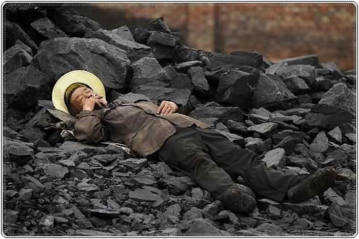 Man sleeping on rocks