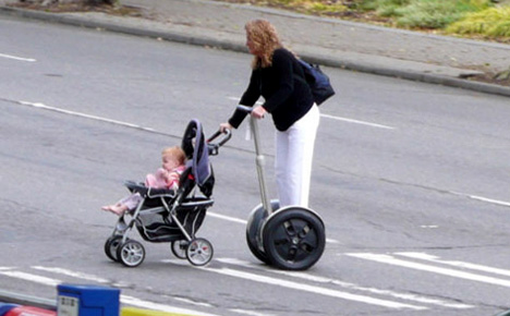 lazy mom on segway pushing baby